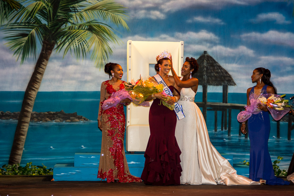 Former Miss Cayman Islands Monyque Brooks crowns the new queen - Anika Conolly.