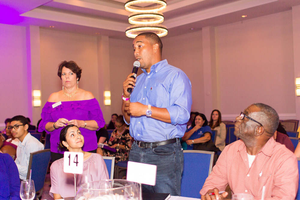 Patron speaking at Cayman's Women's Day Event as Judith Seymour looks on. 