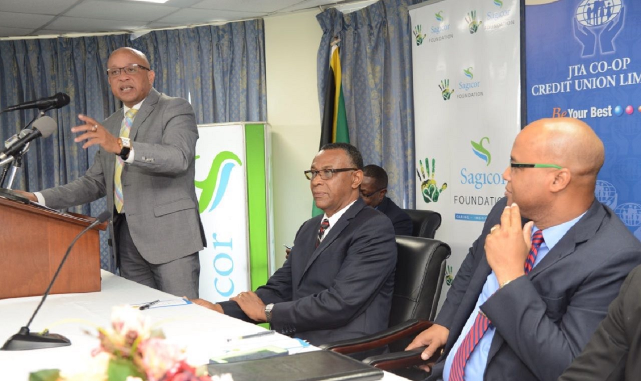 Mark Chisholm (left), executive vice-president of the individual life division at Sagicor, makes his presentation during Thursday's launch of the 2017 JTA/Sagicor National Athletics Championship at the Jamaica Teachers' Association's head office in Kingston.