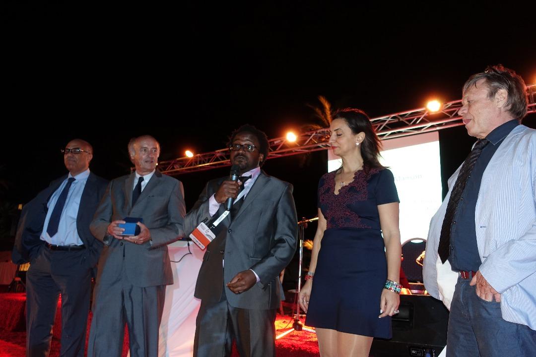 Au centre, micro en main, Ben Manson Toussaint recevant le prix Louis D'Hainaut à Marrakech  Credit photo: Alain Jaillet