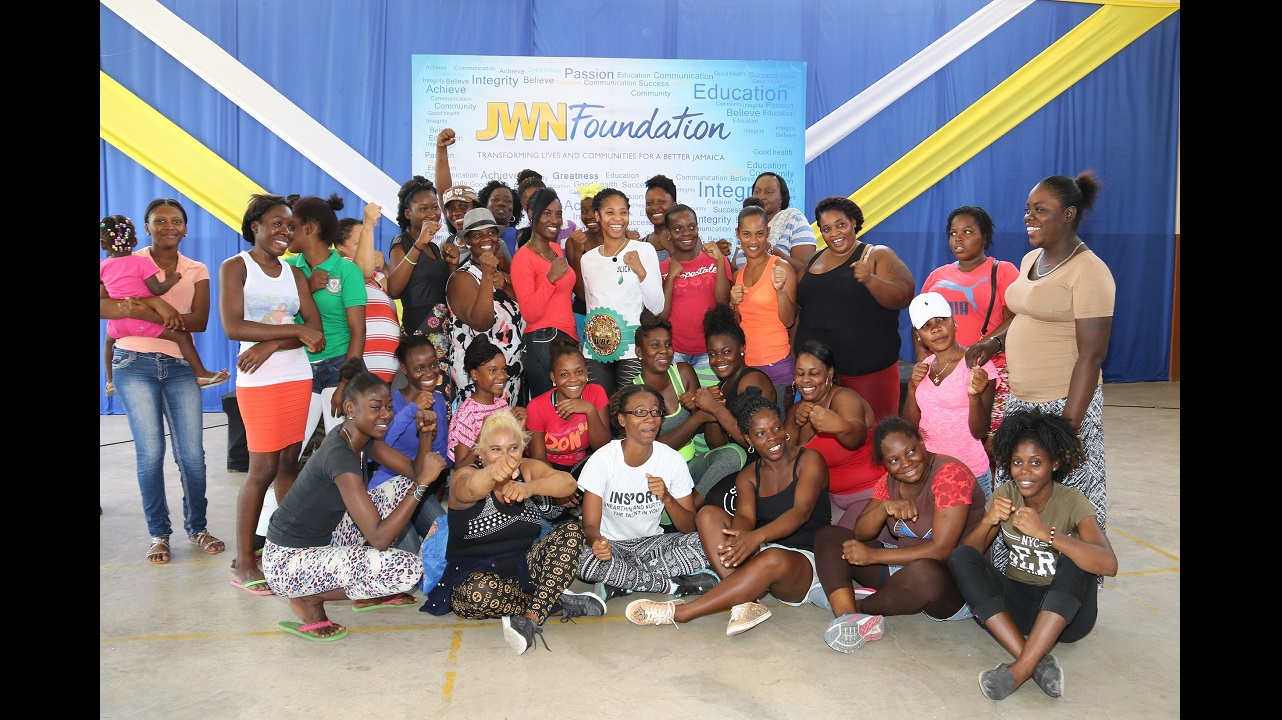 Alicia 'Slick' Ashley (centre) poses with the participants in the self-defense workshop held at the Caribbean Palms Community Centre recently.