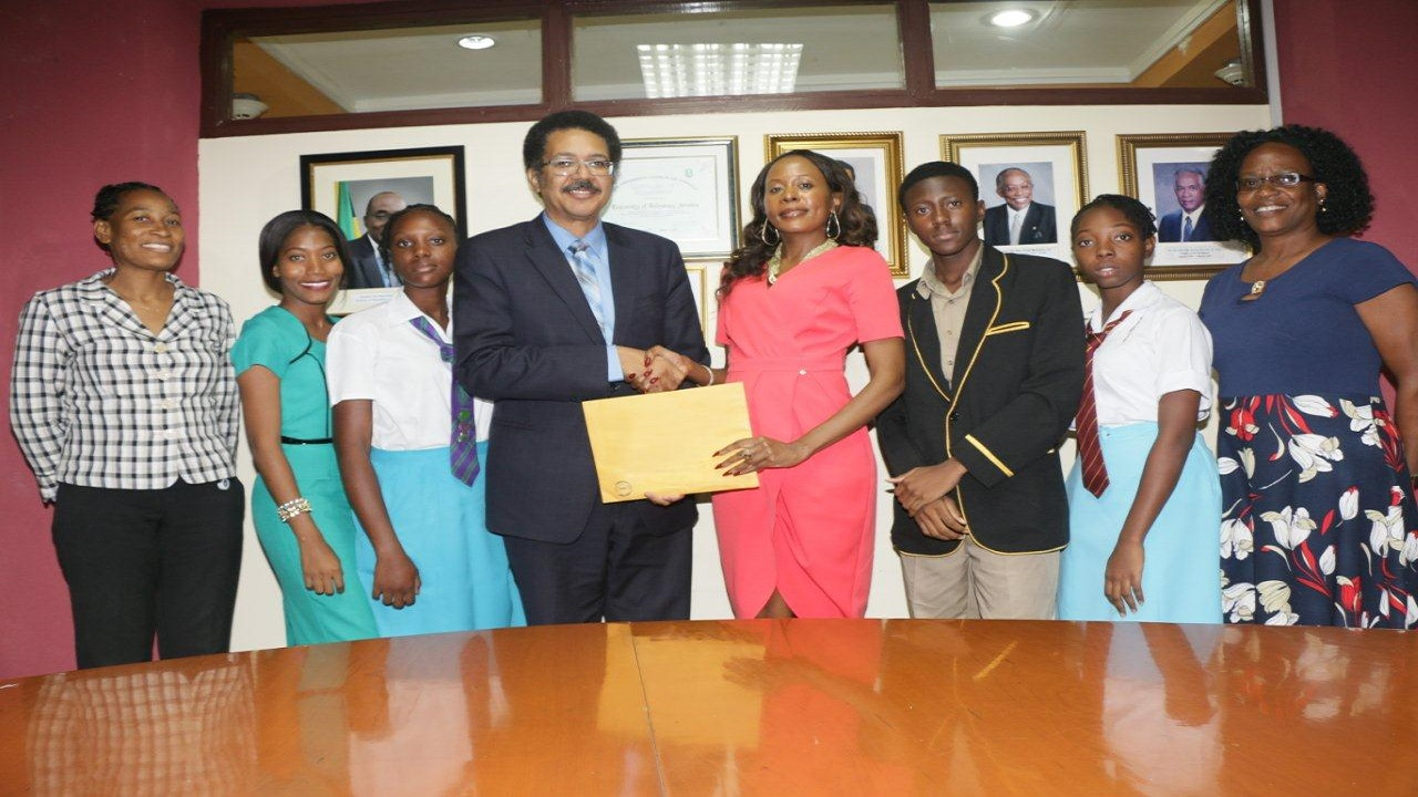 (From left) Nadine Clarke-Thomas (Teacher, Wolmer's Girls), Ramone Daley (Teacher, William Knibb Memorial), Nastacia Linton, (William Knibb Memorial), Professor Stephen Vasciannie (President, UTECH), Rosemary Duncan (Manager, Rita Marley Foundation), Bobby Francis (York Castle High),  Kuankera Wheatley (Wolmer's Girls)), Hyacinth Mears-Griffiths (Teacher, York Castle High).