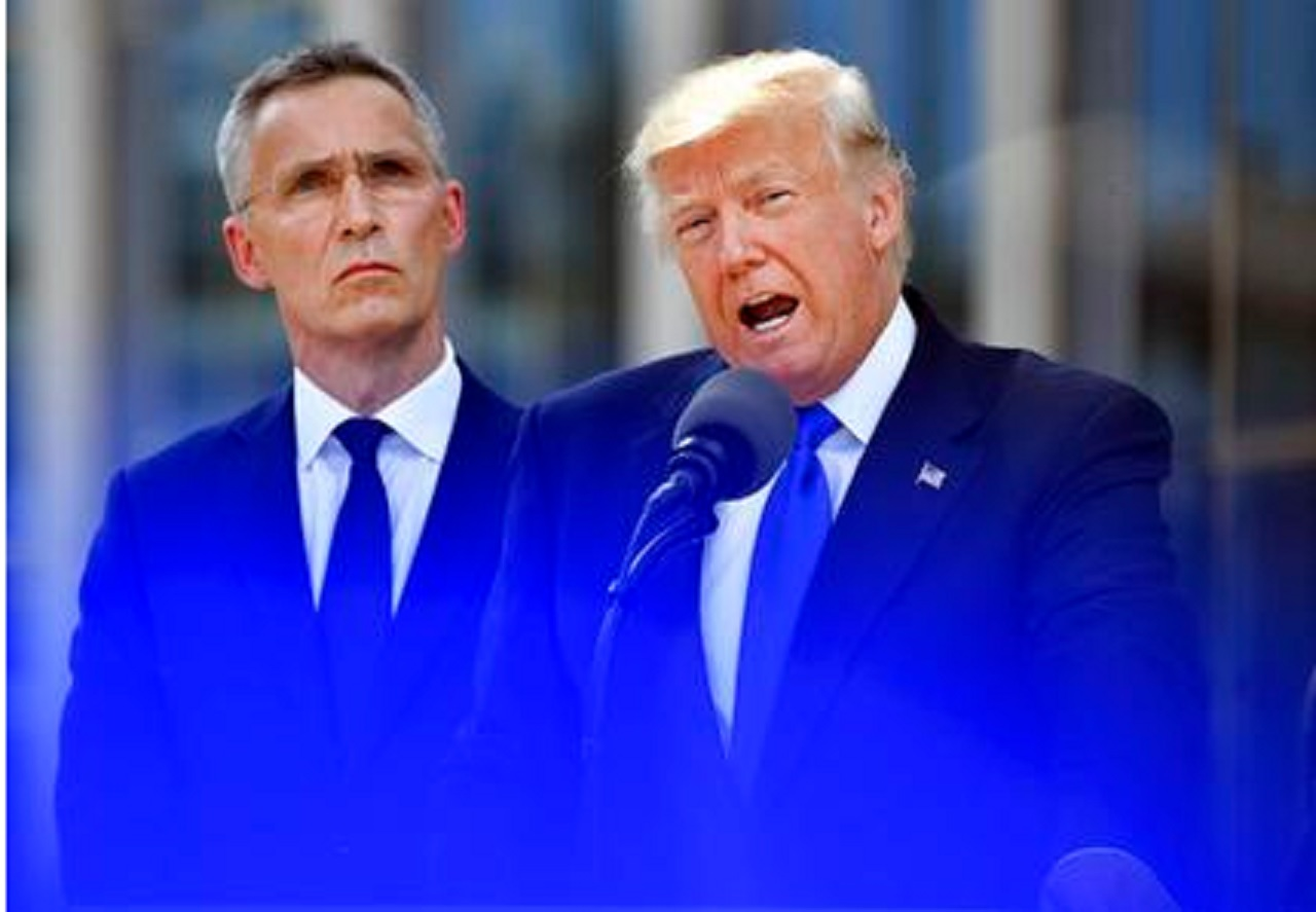 U.S. President Donald Trump, right, speaks as NATO Secretary General Jens Stoltenberg looks on during ceremony at NATO headquarters at the NATO summit in Brussels on Thursday, May 25, 2017.