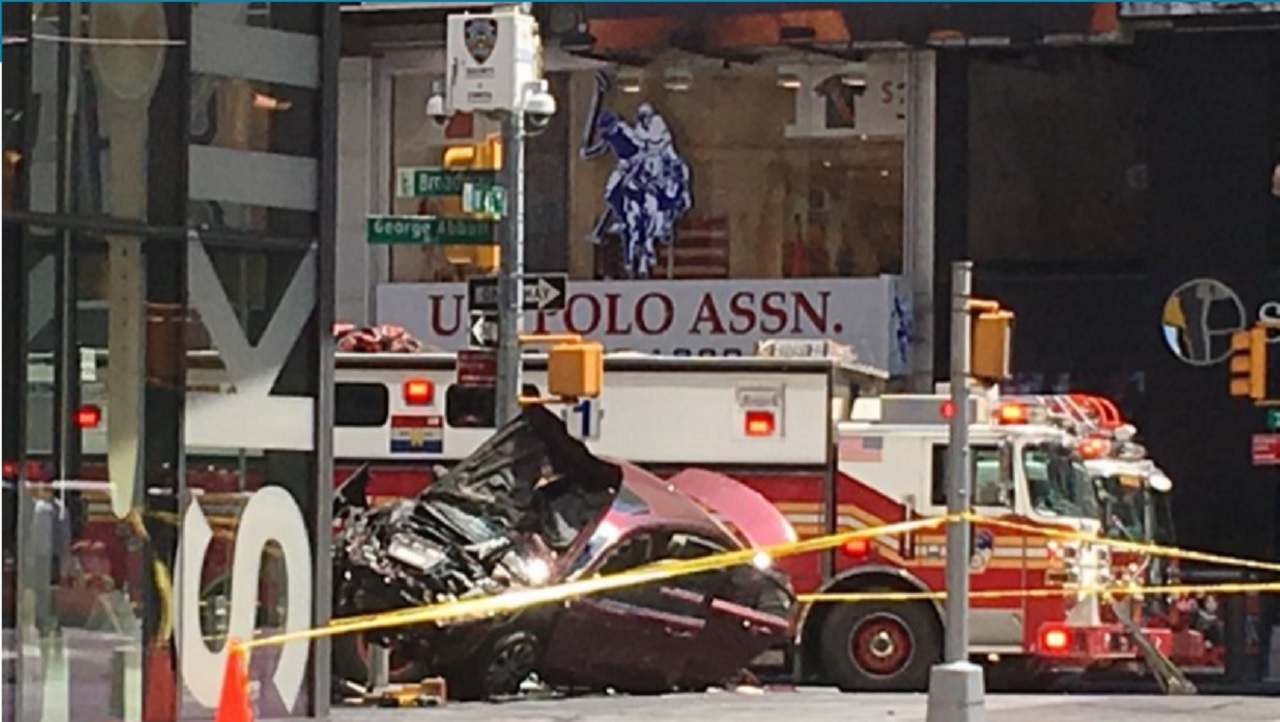 A smashed car sits on the corner of Broadway and 45th Street in New York's Times Square after driving through a crowd of pedestrians Thursday, May 18, 2017.