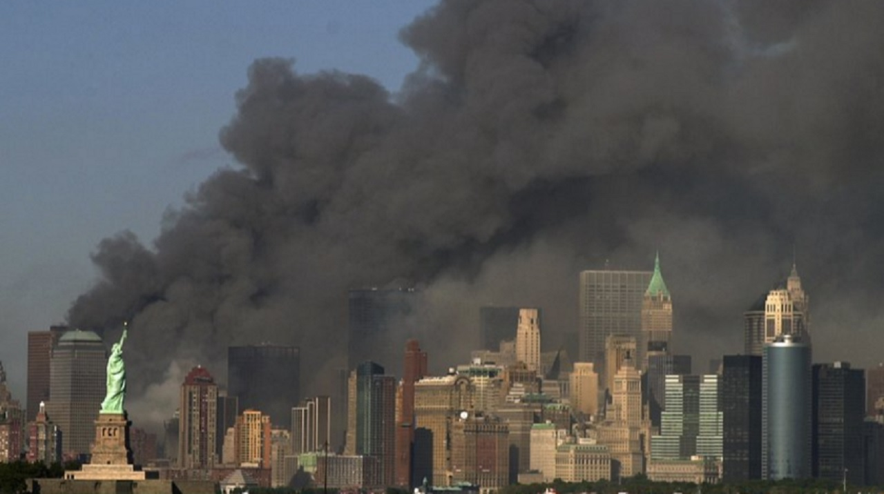 FILE -- In this Sept. 11, 2001 file photo, thick smoke billows into the sky from the area behind the Statue of Liberty, lower left, where the World Trade Center towers stood. A Saudi-funded lobbying campaign involving U.S. military veterans saw some organizers disclose their activities late or vaguely.