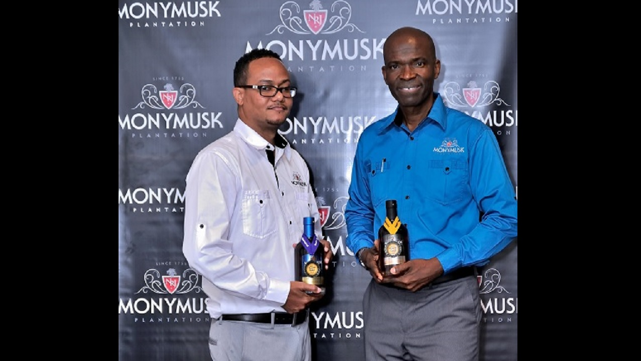 Winston Harrison (right), CEO of National Rums of Jamaica, the parent company of the Monymusk Plantation brand, and commercial manager Damian Graveley, pose with awards the company won at the  2017 Miami Rum Festival.