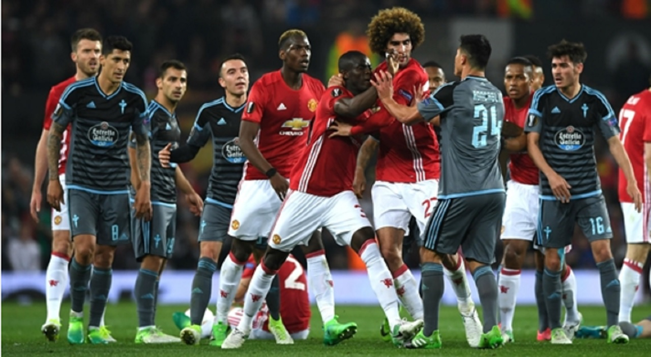 Manchester United and Celta Vigo players clash at Old Trafford.