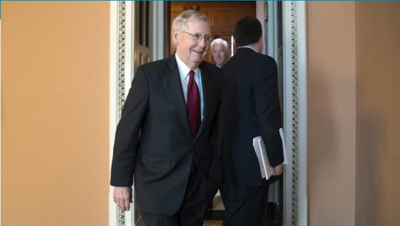 In this May 10, 2017, photo, Senate Majority Leader Mitch McConnell, R-Ky., leaves a closed-door Republican strategy session at the Capitol in Washington, the day after the firing of FBI Director James Comey by President Donald Trump.