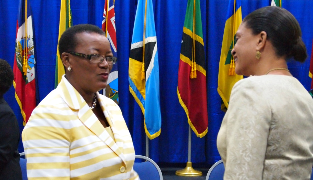 Left: Senator Maxine McClean, Barbados' Minister of Foreign Affairs chatting with ELma Gene Issac, Ambassador to CARICOM and the OECS for Saint Lucia