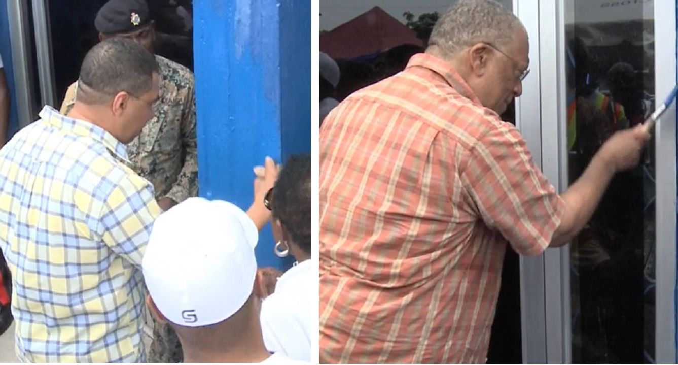 Prime Minister Andrew Holness (left) and Opposition Leader Dr Peter Phillips gave helping hands at the Ward Theatre in downtown Kingston on Labour Day.