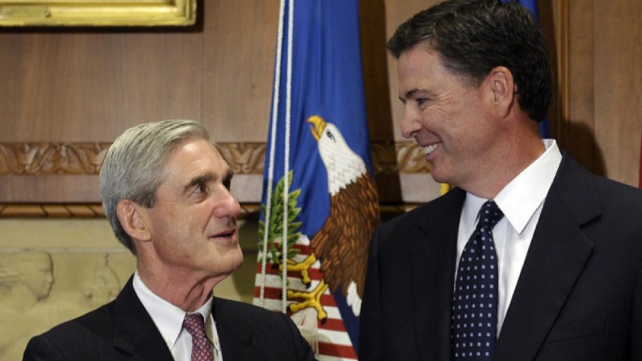In this Sept. 4, 2013 file photo, then-incoming FBI Director James Comey talks with outgoing FBI Director Robert Mueller before Comey was officially sworn in at the Justice Department in Washington. On May 17, 2017.