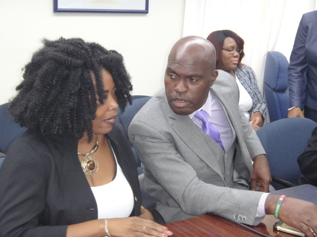 Left to right: President of the Barbados Road Safety Association, Sharmane Roland-Bowen and Minister of Transport and Works,  Michael Lashley.