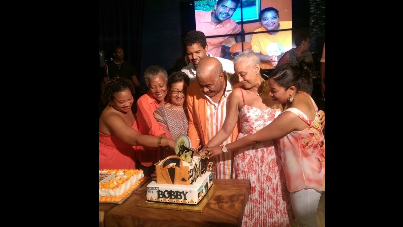 PNP chairman Robert Pickersgill (third right) cuts his cake with family members