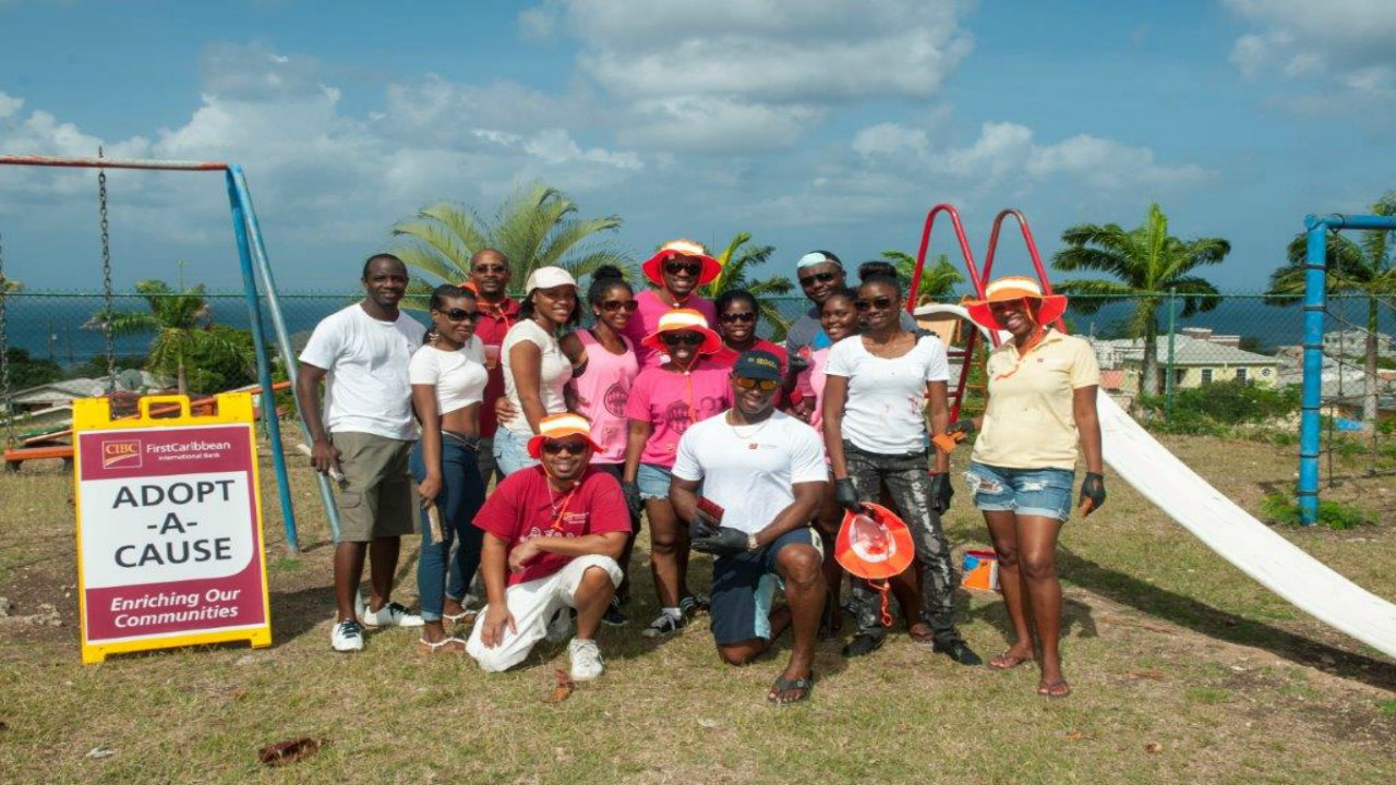 Team Warrens taking a break from their labour of love at West Terrace Primary School. (Photo Credit: CIBC FirstCaribbean)