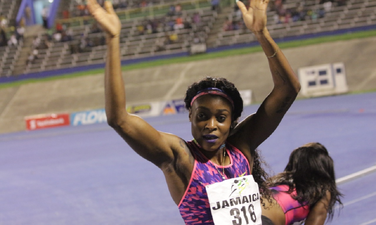 Reigning Olympic sprint double champion Jamaican Elaine Thompson  acknowledges the crowd after winning the women's 200