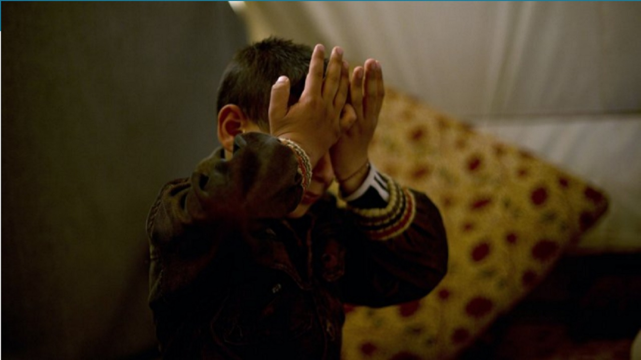 Ten-year-old Akram Rasho Khalaf pauses as he talks about how he had been captured at the age of 7 and trained by Islamic State militants, at the Khabarto Camp for internally displaced people in Dahuk, Iraq, on Friday, April 14, 2017.