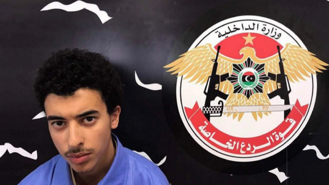 In this Wednesday, May 24, 2017 photo, Hashim Ramadan Abedi appears inside the Tripoli-based Special Deterrent anti-terrorism force unit after his arrest on Tuesday for alleged links to the Islamic State extremist group. Abedi is the brother of Salman Abedi, who has been identified as the man behind the bombing that killed 22 people and wounded scores at an Ariana Grande concert Monday night in Manchester.