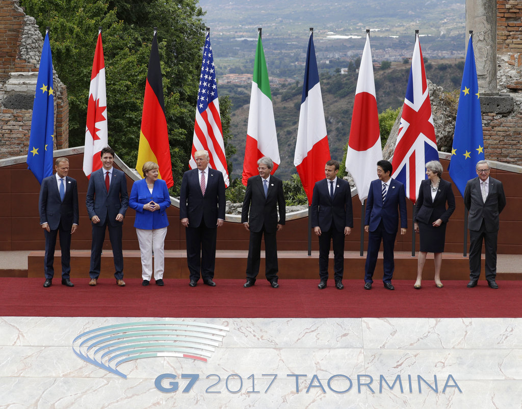 Leaders of the G7, from left, European Council President Donald Tusk, Canadian Prime Minister Justin Trudeau, German Chancellor Angela Merkel, U.S. President Donald J. Trump, Italian Prime Minister Paolo Gentiloni, French President Emmanuel Macron, Japan's Prime Minister Shinzo Abe, British Prime Minister Theresa May and European Commission President Jean-Claude Juncker pose during a group photo for the G7 summit in Taormina, Italy.
