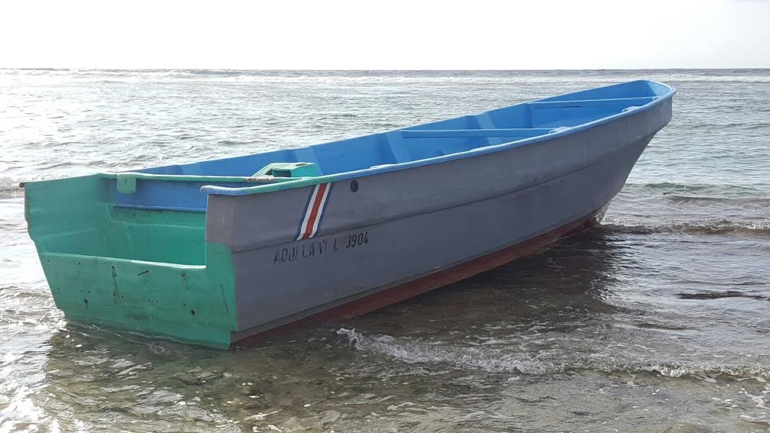 Photo of boat that washed ashore near Bodden Town beach provided by the Royal Cayman Islands Police Service (RCIPS)