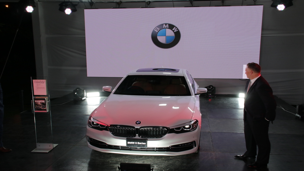 Matthew Cripps, ATL Automotive Group General Manager, unveils the new BMW 5 series (PHOTO: AP)