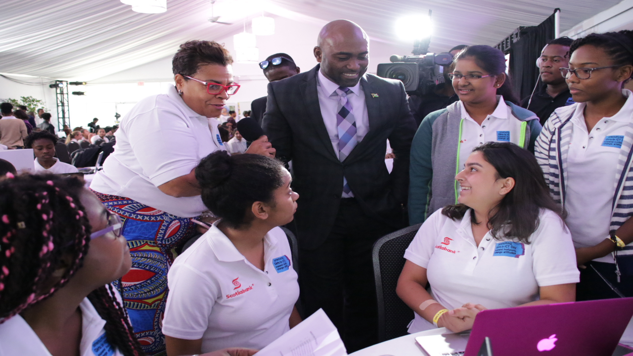 Technology minister Dr Andrew Wheatley engage girls at the International Telecommunications Union's (ITU) Girls in Information and Communication Technology (ICT) Day Caribbean Hackathon  event in Jamaica last week.