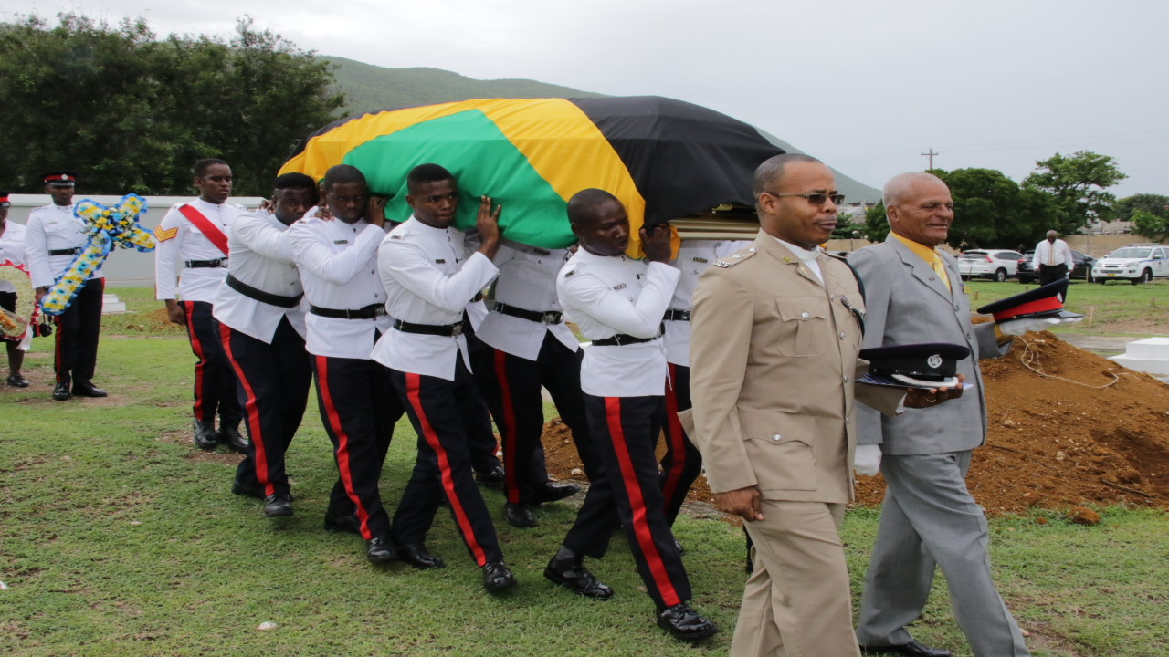 Pall bearers carry the body of the late Corporal Courtney Robinson on Thursday at Briggs Park Cemetery, Up Park Camp. (PHOTO: Llewellyn Wynter)