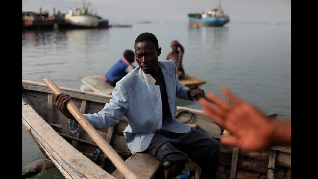A man rows a small boat off Port-au-Prince, Haiti in 2010, after a massive earthquake hit that Caribbean country. (PHOTO: AP)