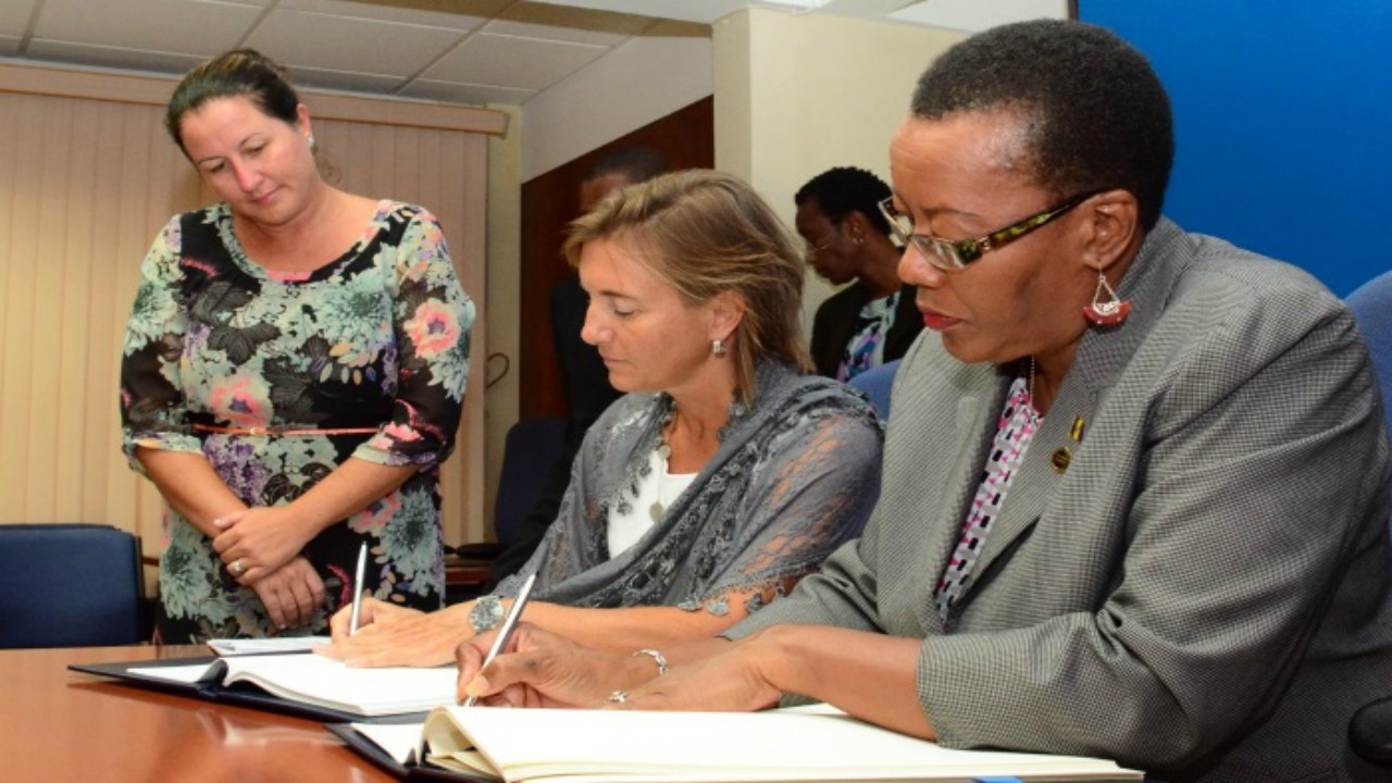Minister of Foreign Affairs and Foreign Trade, Senator Maxine McClean, and Canada's High Commissioner to Barbados, Marie Legault, signing the new Air Transport Agreement at the Ministry of Foreign Affairs. (C.Pitt/BGIS)