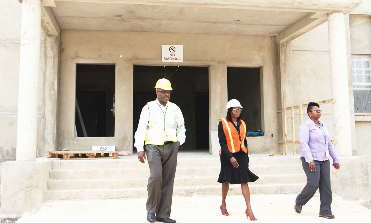From Left: Attorney General Adriel Brathwaite and Registrar of the Supreme Court, Barbara Cooke-Alleyne touring the new District D Complex.