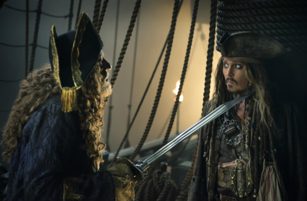 "n this image released by Disney, Geoffrey Rush portrays Barbossa, left, and Johnny Depp portrays Captain Jack Sparrow in a scene from ""Pirates of the Caribbean: Dead Men Tell No Tales."" (Peter Mountain/Disney via AP)"