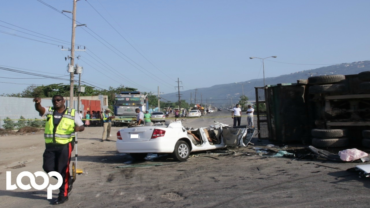 The scene after the crash involving an alleged stolen motor car and a garbage truck along the Spanish Town Road in Kingston. (PHOTO: Llewellyn Wynter)
