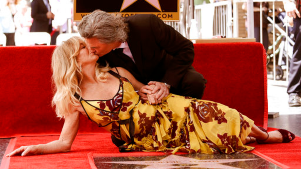 Goldie Hawn and Kurt Russell kiss at a ceremony honoring the couple each with stars on the Hollywood Walk of Fame on Thursday, May 4, 2017, in Los Angeles. (Photo by Richard Shotwell/Invision/AP)