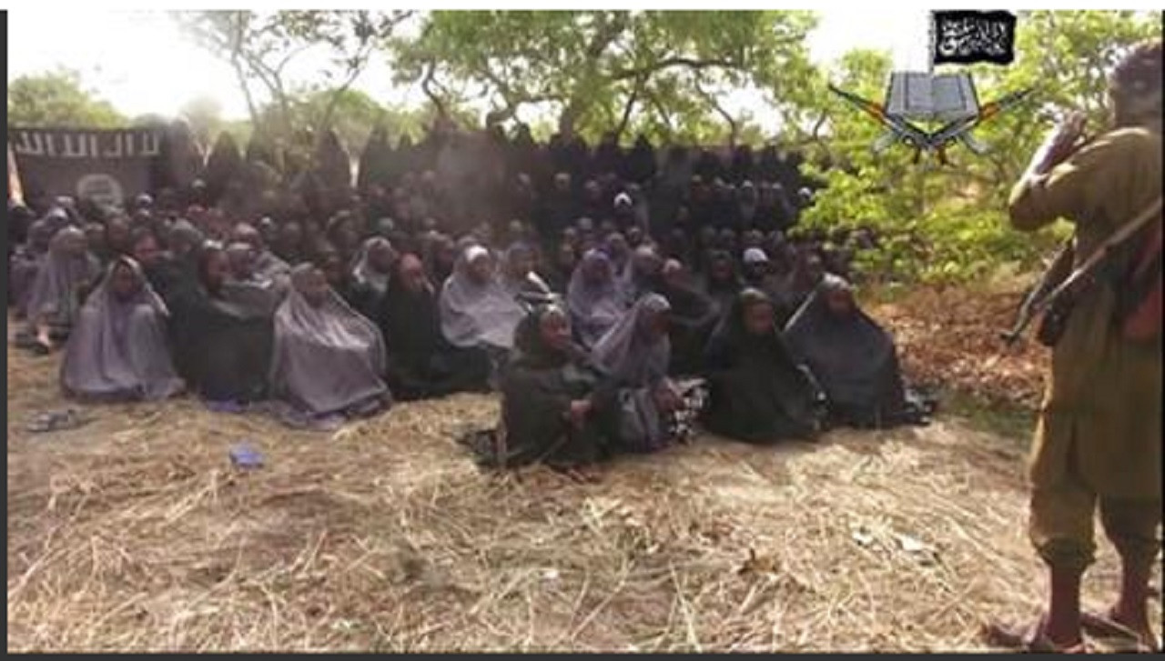 This Monday, May 12, 2014 file image taken from video by Nigeria's Islamic extremist network, shows the alleged missing girls abducted from the northeastern town of Chibok.