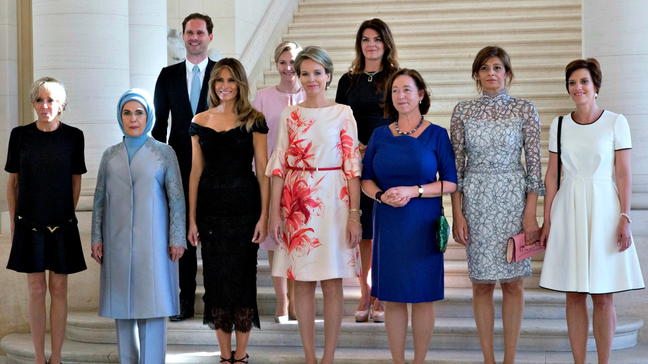 From left, France's Brigitte Trogneux, Turkey's Emine Erdogan, Luxembourg's Gauthier Destenay, US Melania Trump, Slovenia's Mojca Stropnik, Queen Mathilde of Belgium, Iceland's Thora Margret Baldvinsdottir, Norway's Ingrid Schulerud - Stoltenberg, Bulgaria's Desislava Radeva and Belgium's Amelie Derbaudrenghien pose for a group photo during the spouse and partner program at the Royal Castle of Laeken in Brussels on Thursday, May 25, 2017. (AP Photo/Virginia Mayo)