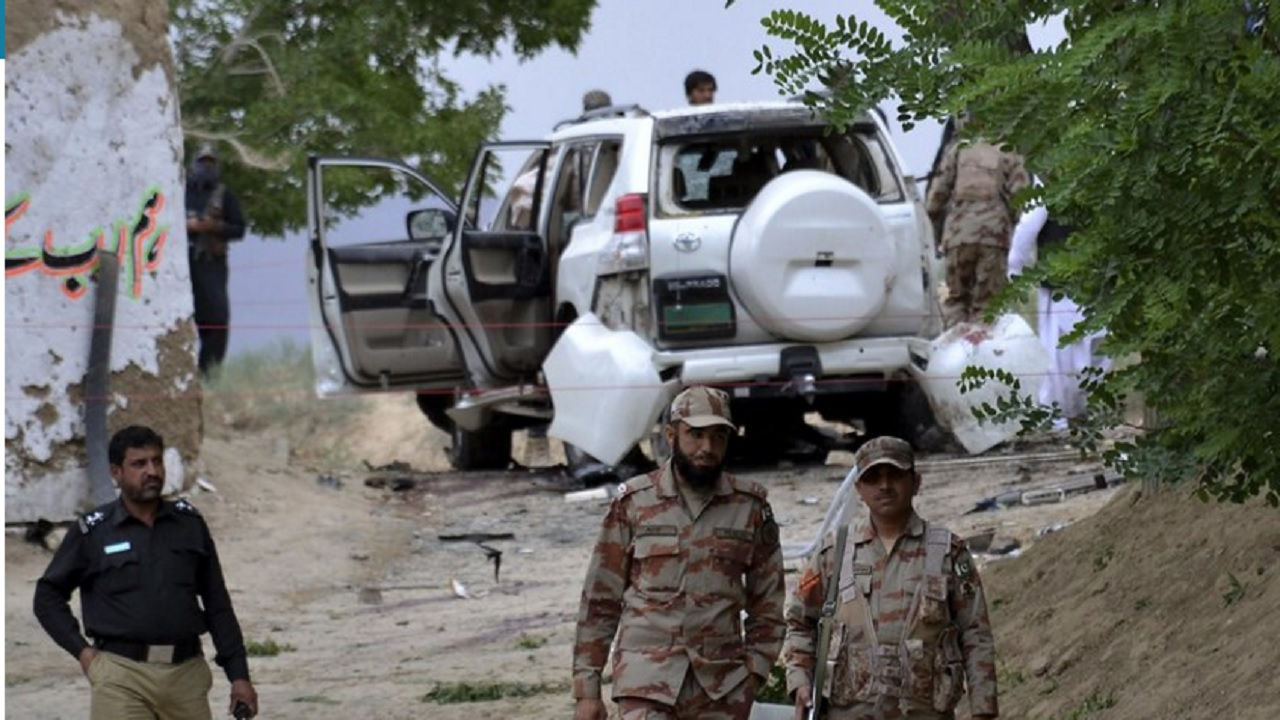 Pakistani security officials stand guard at the site of a suicide bombing which killed dozens of people and left many injured in Mastung district near Quetta, Pakistan, Friday, May 12, 2017.