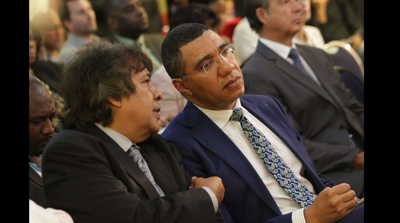 Prime Minister Andrew Holness (right) in discussion with Guardsman boss Kenny Benjamin at a security forum at Knutsford Court Hotel on Thursday. (PHOTO: Marlon Reid)
