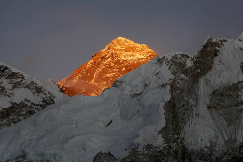 In this Nov. 12, 2015, file photo, Mt. Everest is seen from the way to Kalapatthar in Nepal. An American climber has died near the summit of Mount Everest and an Indian climber is missing after heading down from the mountain following a successful ascent, expedition organizers said Sunday. (AP Photo/Tashi Sherpa, File)