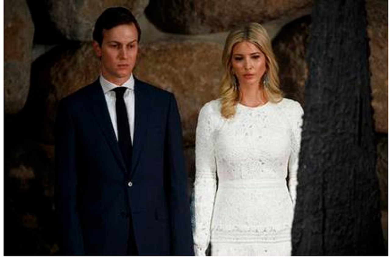 In this May 23, 2017, photo, White House senior adviser Jared Kushner, left, and his wife Ivanka Trump watch during a visit by President Donald Trump to Yad Vashem to honor the victims of the Holocaust in Jerusalem. (AP Photo/Evan Vucci)