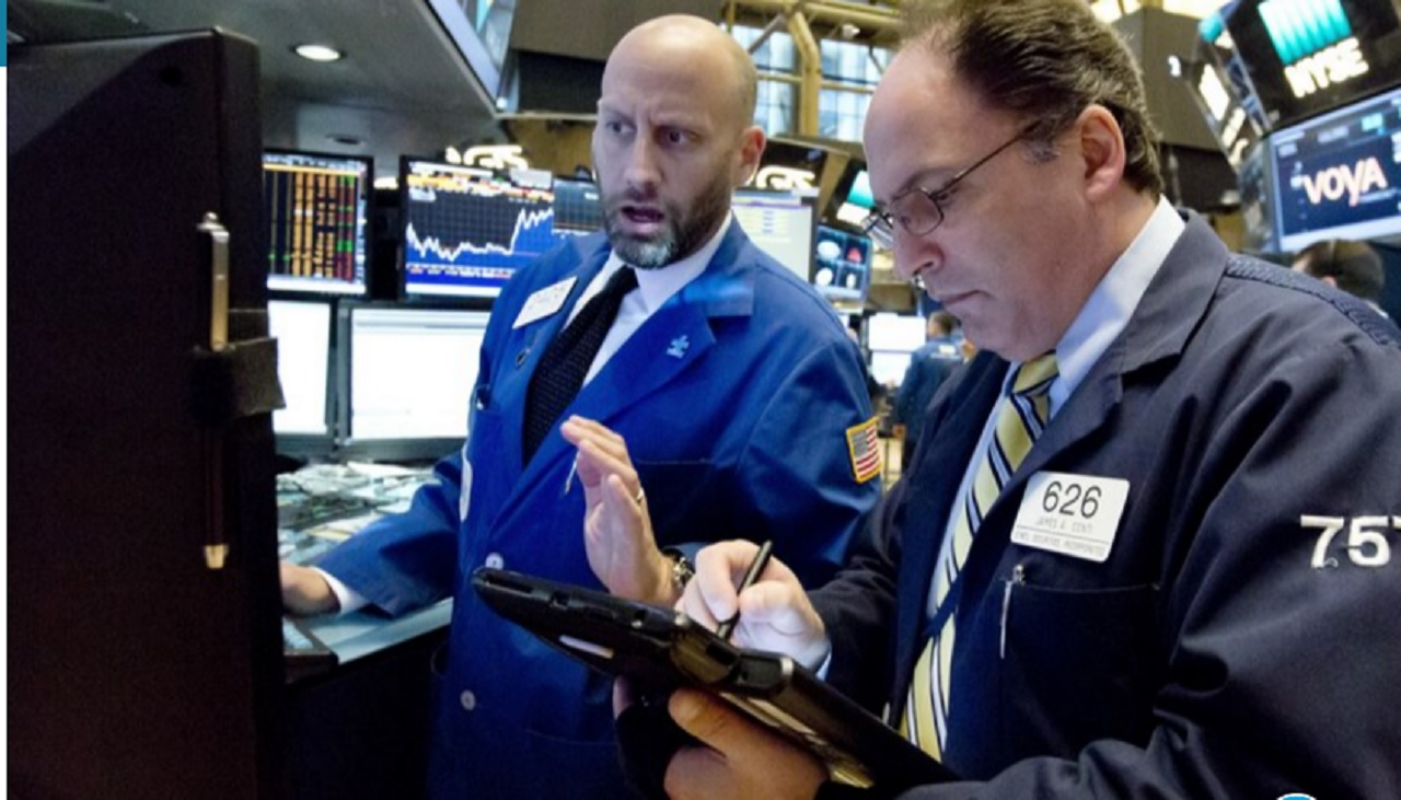 Specialist Meric Greenbaum, left, and trader James Conti work on the floor of the New York Stock Exchange, Wednesday, May 17, 2017. Stocks are opening lower on Wall Street as banks and industrial companies fall.