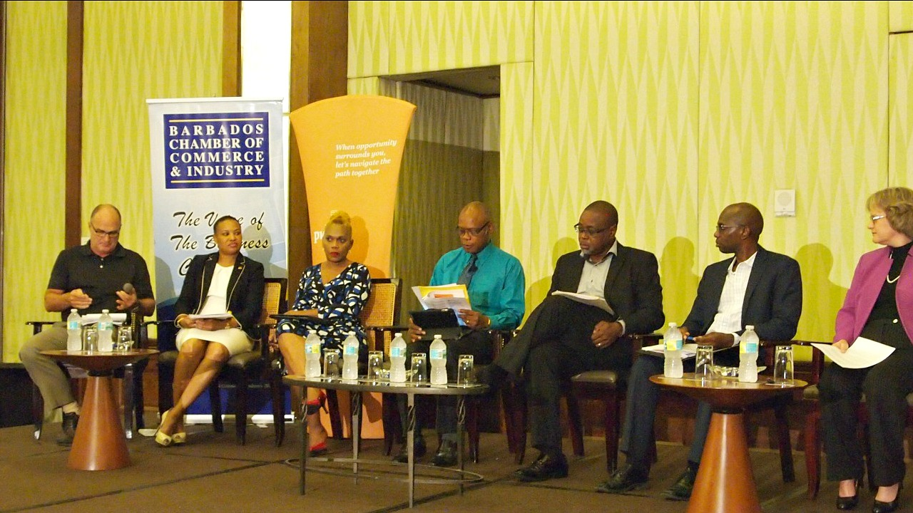 Panel: (L-R) Charles Herbert Chairman of the Barbados Private Sector Association (BPSA), Donna Wellington, President of the Barbados Bankers Association, Roseanne Myers, Chairman of the Barbados Hotel and Tourism Association (BHTA), David Ellis, Program Manager at Starcom Network, Oliver Jordan, Advisory Leader at Pricewater House Coopers (PwC), Winston Moore, Head of Economics Department at the University of the West Indies (UWI), Gloria Eduardo, Tax Leadeer at Pricewater House Coopers (PwC).