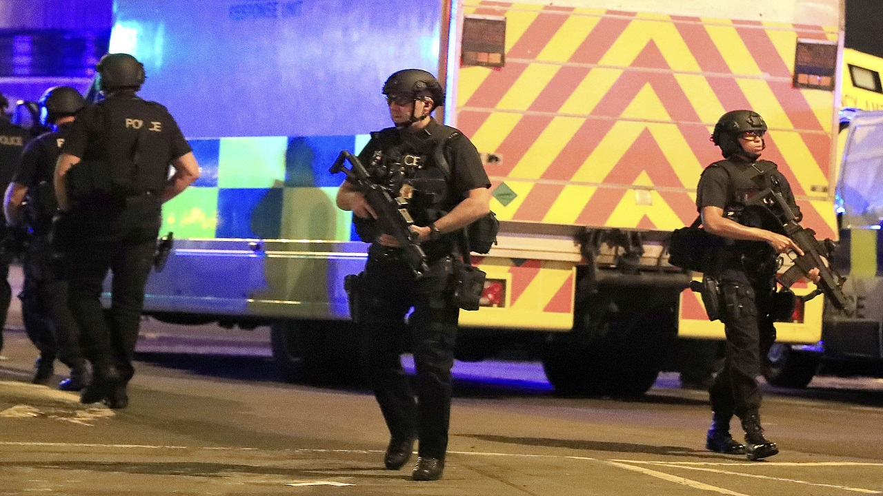 Armed police respond after reports of an explosion at Manchester Arena during an Ariana Grande concert in Manchester, England, Monday, May 22, 2017. (PHOTO: AP)