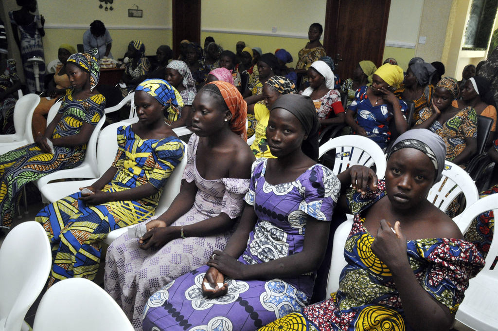 Chibok school girls recently freed from Boko Haram captivity are seen in Abuja, Nigeria, Sunday, May 7, 2017. The 82 freed Chibok schoolgirls arrived in Nigeria's capital on Sunday to meet President Muhammadu Buhari as anxious families awaited an official list of names and looked forward to reuniting three years after the mass abduction. (AP Photo/ Olamikan Gbemiga)
