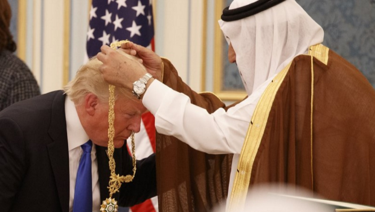 Saudi King Salman presents President Donald Trump with The Collar of Abdulaziz Al Saud Medal at the Royal Court Palace, Saturday, May 20, 2017, in Riyadh