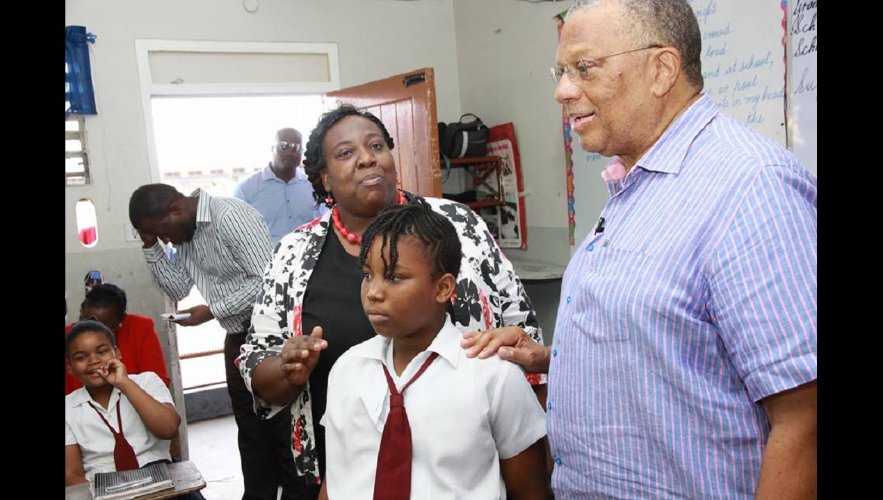 Opposition Leader Dr Peter Phillips takes part in Read across Jamaica Day activities at the Half Way Tree Primary School on Tuesday.