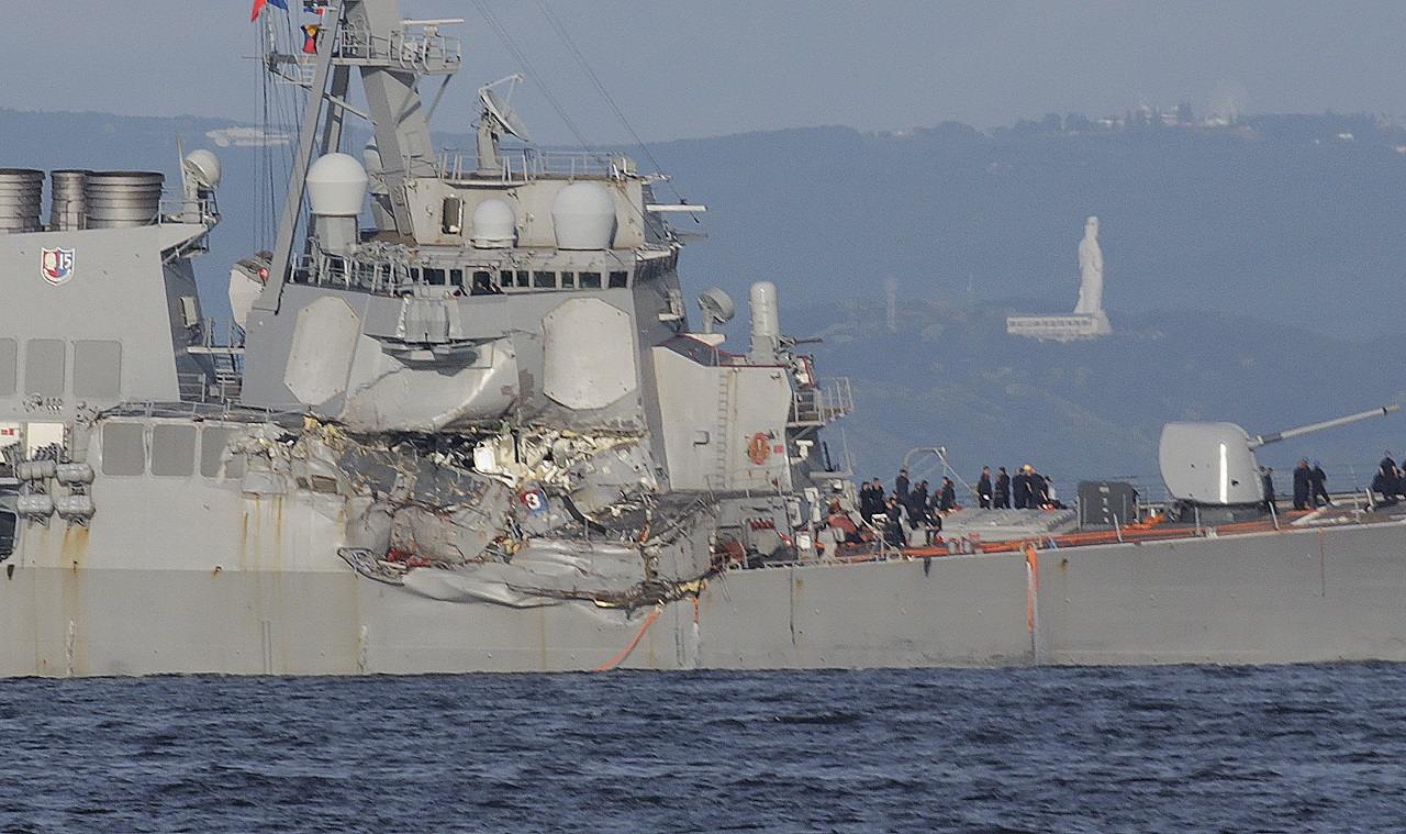 The damaged USS Fitzgerald is seen near the U.S. Naval base in Yokosuka, southwest of Tokyo, after the U.S. destroyer collided with the Philippine-registered container ship ACX Crystal in the waters off the Izu Peninsula Saturday, June 17, 2017.