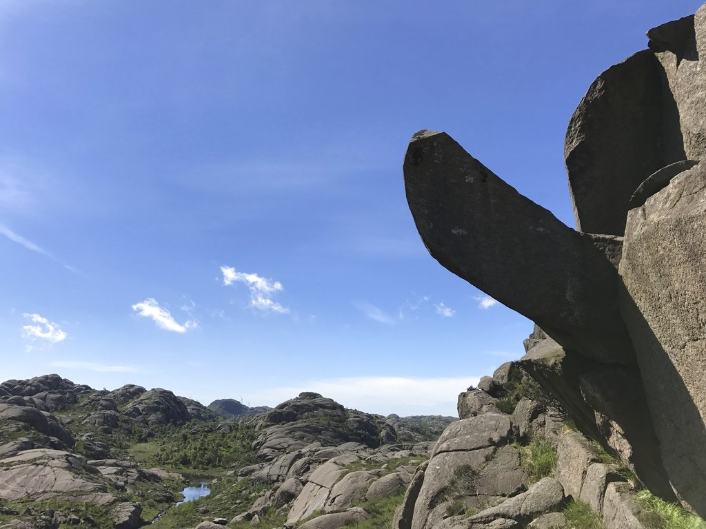 This undated photo shows the rock formation Trollpikkenin before its damage, in Egersund, western Norway. A group of activists have started to collect money to repair the penis-shaped rock formation and a popular tourist attraction after it was found badly damaged Saturday June 24, 2017. It was discovered cracked complete with drilling holes in the rock - something that experts say suggests strongly that it was cut off on purpose. (Ingve Aalbu/NTB Scanpix via AP)