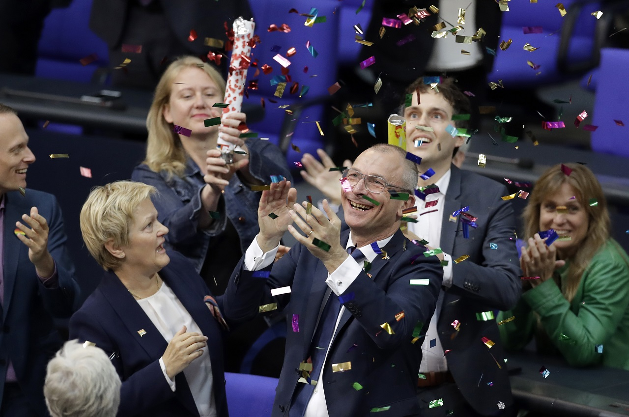 Green Party's gay rights activist Volker Beck, front right, and fellow faction members celebrate with a confetti popper after German Federal Parliament, Bundestag, voted to legalize same-sex marriage in Berlin, Germany, Friday, June 30, 2017.