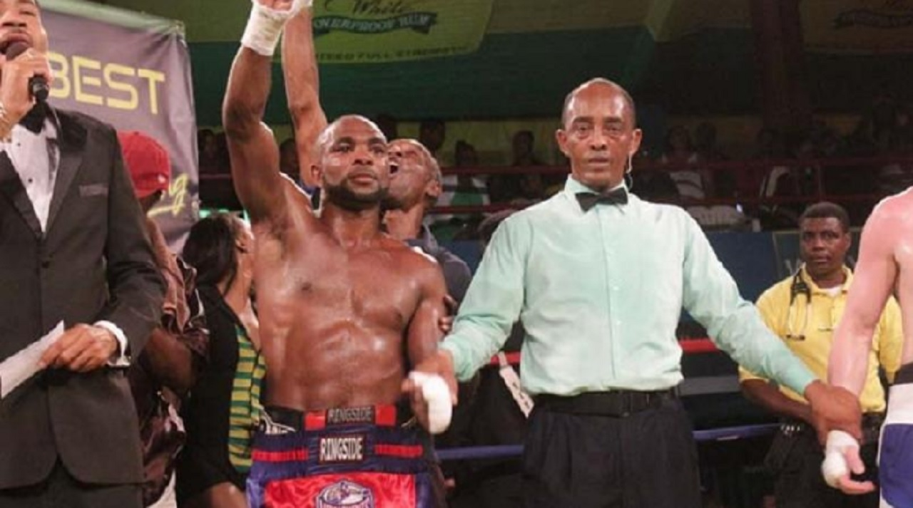 Jamaican Tsetsi Davis raises his hand after it was declared that he scored a split decision victory over Canadian Dave Leblond in the third bout of the 2017 Wray and Nephew Contender Boxing Series on April 19.