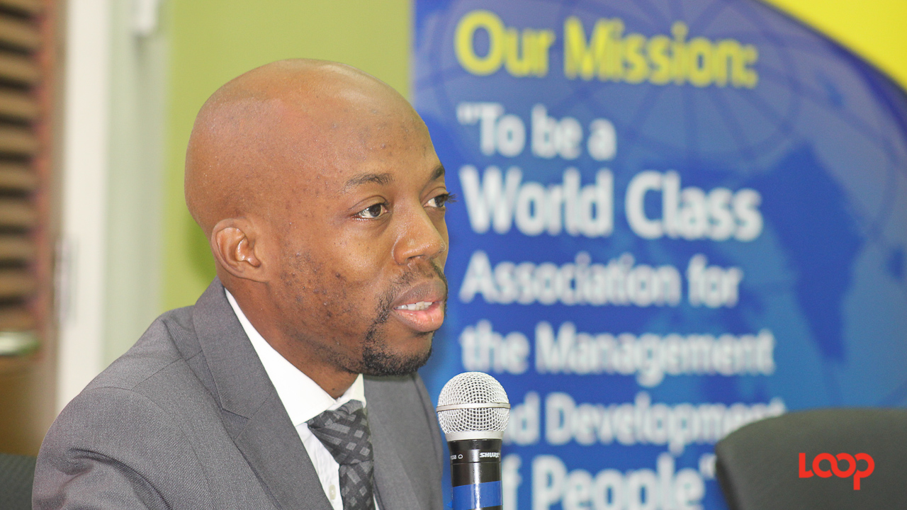 Attorney and member of the Employment Rights Tribunal, Omari Drakes speaking at the HRMAB session on Sexual Orientation, Sexual Harassment and Social Media in the Workplace.'