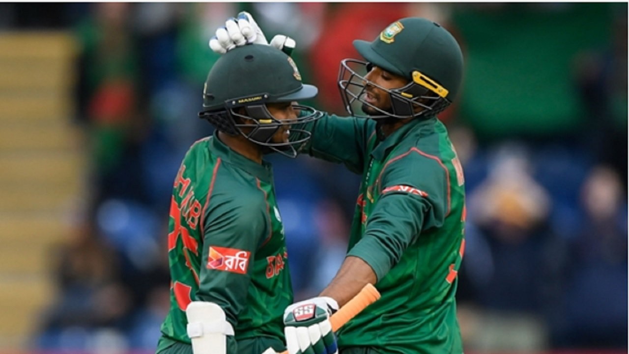 Shakib Al Hasan celebrates reaching his century with Mahmudullah.